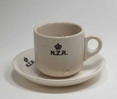 Bill ✔️ Crown Lynn, NZR Railway cup saucer, Auckland, New Zealand. Collection of Auckland Museum I'm guessing at circa Ppcv New Zealand Architecture, Kiwiana, Fine China, Cup And Saucer, Four Square, Tea Pots, Auckland, Pottery, Ceramics