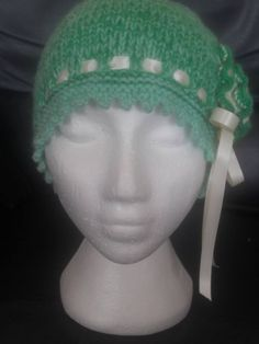 Picot edged Green coloured Beanie with Large contrasting flower on side. Get ready for winter with this beautiful Hand Knitted warm and cosy hat