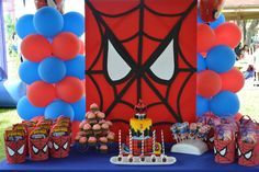 Awesome dessert table and backdrop at a Spiderman superhero boy birthday party!  See more party ideas at CatchMyParty.com!