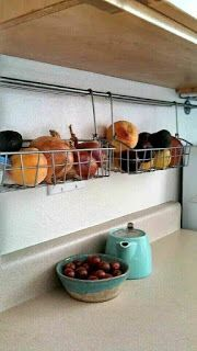 51 Clever Storage Hacks to Maximize Small Kitchens - Simple Life of a Lady Save on counter space by using baskets to lift fruits, vegetables, and spices. More ideas here for organizing limited kitchen space. Interior Simple, Home Interior, Interior Design, Apartment Interior, Kitchen Interior, Apartment Furniture, Interior Modern, Kitchen Designs, Kitchen Furniture