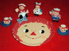 Miniature resin Raggedy Ann & Andy tea set.