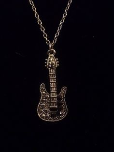 "Guitar Pendant Necklace, Stamped signed ""Claire's"",5 Black Onyx Gemstones Guitar Base, Back Reads:""Forever"" Silver Chain Rock and Roll DWedgeCreations​ dwedgecreations.etsy.com #Dwedgecreations #GuitarPendant #RockandRoll #ClairesNecklace #SignedClaires #Claires #GuitarNecklace #BlackOnyx	#RockandRollGuitar #ForeverNecklace #SilverGuitar #LoveMusic #GuitarMusic	#ForeverPendant #ForeverLove #Fashion #style #beautiful #guitar #love #glamour #design #etsy #etsyshop #etsyseller"
