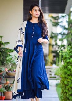 The kurta and pants are primary with a straight cut, what accentuates it is the beautiful floral block printed dupatta with tassels and detailing at the neck, on the sleeves and as potli buttons on the side seam. Pakistani Fashion Casual, Pakistani Dresses Casual, Pakistani Dress Design, Indian Fashion, 80s Fashion, Fashion Dresses, Fashion Tips, Dress Indian Style, Indian Outfits