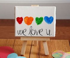 Fingerprint Hearts on a mini Canvas and Art Easel (Jo-Ann's). Message is made from Rub-on Letters. So cute for a Mother's Day or Father's Day or for grandparents! - Do this same idea on paper and send it to your sponsored kids! Mothers Day Crafts For Kids, Fathers Day Crafts, Easy Crafts For Kids, Valentine Day Crafts, Holiday Crafts, Art For Kids, Valentines, Craft Activities, Preschool Crafts