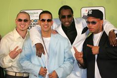 Daddy Yankee Photos Photos - Rappers Pitbull, (L) Daddy Yankee (2nd-L) and Sean 'P Diddy' Combs (C) pose backstage at 2005 Billboard Latin Music Awards at the Miami Arena April 28, 2005 in Miami, Florida. - 2005 Billboard Latin Music Awards - Pressroom