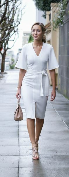 2016 Spring / Summer Dress MEMO: The ultimate dress guide for every warm weather occasion or event this spring and summer! Sunday Best Dress {white knee length v-neck wrap dress, lace up heeled sandals, pony tail hairstyle} Dress