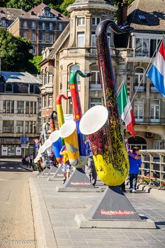 Large saxophones on a bridge in Dinant, the city where Adolphe Sax was born. Belgium.