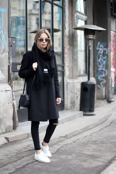 You simply can't go wrong with an all black outfit consisting of skinny black jeans and an overcoat, like this one by Vanja Milicevic. Try breaking up the black by pairing the look with white...