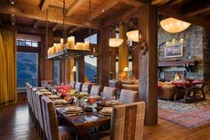 Grand Dining Room exudes rustic warmth in Luxury Montana Cabin [3000 x 2000]