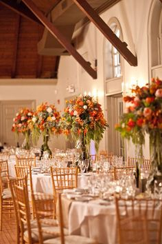 Giant coral and pink floral arrangements. Photo by Brookelyn Photography.