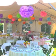 Making tissue paper flowers helped transform this tent for a bridal shower. It was fairly inexpensive and  once you get the swing of it it's easy.