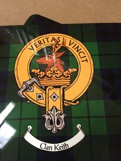 Set of four small size place mats with Keith clan crest and tartan print design.
