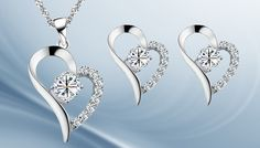 18ct White Gold Plated Heart Necklace & Earrings with Free Gift Dazzle your peers with 18ct. White Gold Plated Heart Necklace  and  Earrings      Necklace pendant measures 28mm x 15mm, with middle stone of 6mm x 6mm      Earrings measure 18mm x 14mm, with middle stone 5mm x 5mm      White gold plating with exceptional workmanship      Attractive heart-shaped motifs      Both central stones...