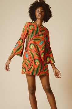 Red floral mini dress with maxi sleeves in African textiles. Fair trade fashion for women who love eco-friendly sustainable clothing