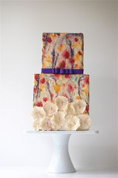The use of bold colors like purple, fuchsia and bright yellow are toned down on this wedding cake because of the artistic watercolor technique that was used. Gorgeous!