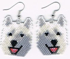2 Hand Beaded laughing white wolf, malamute, husky earrings with no fringe.