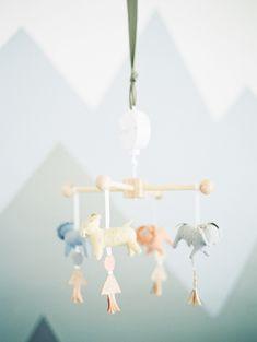 modern nursery with plush animal mobile - Melissa Jill Photography