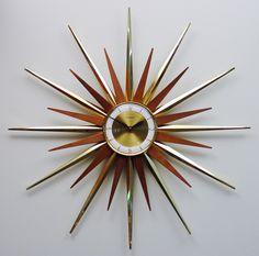 Mid Century Modern Starburst Wall Clock by Forestville, Atomic Fireworks Starburst Modern 1960s Hanging Clock. 275.00, via Etsy.
