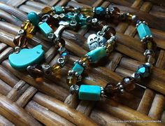 Pet Neckwear/Turquoise Pet Necklace/Dog Bone Pet Necklace/Handmade Pet Necklace/I Love My Dog Charm/Turquoise Bear Bead/Pet Neckwear Southwestern style adorable pet necklace or if your wrist is small you can wrap it and its a human bracelet! Its strung on black stretch magic and has a dog bone charm, paw print/I heart my dog charm (both non nickel) genuine turquoise beads, daisy spacers, turquoise stone bead bead, crystal beads, glass beads, and tiny Karen ...