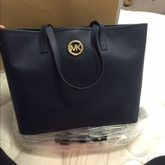 Authentic NWT Michael Kors Jet set Tote - large Navy blue MK tote. Never been used. Still in plastic. All tags are attached. Michael Kors Bags Totes