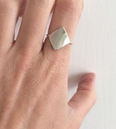 Love this idea of wearing a little shield to protect yourself. :: Shield Two Sterling Silver Ring by Gunnard Jewelry