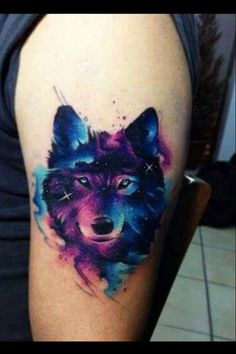 Watercolor wolf tattoo.