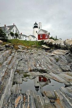Maine, the way life should be. Beautiful lighthouse on Maine's rocky coastline.