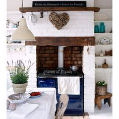White painted brick kitchen Create a classic country kitchen by painting the… Aga Kitchen, Country Kitchen, Kitchen Dining, Kitchen Decor, Kitchen Ideas, Rustic Kitchen, Decorating Kitchen, Vintage Kitchen, Cottage Kitchens