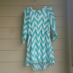 Mint and white chevron dress 3/4 length sheer sleeves with elastic bands at the end.elastic band around waist. Loops for belt but bought without belt. Built in lining. 100% polyester. sequin hearts Dresses Mini