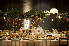 Hanging Floral Installation above long table seating - Created by Green and Bloom Events, AVIdeas Corporate & white+white weddings and events. Photography Studio Sixty Photo