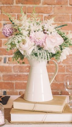 cream jug wedding centrepieces. Look lovely in kitchen window, change up flower colours for different looks And seasons