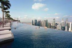 The famed rooftop infinity pool at the Gold-Listed Marina Bay Sands resort in Singapore is 150m long and set into a cantilevered platform overhanging the hotel.