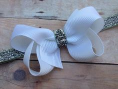 White boutique bow on silver glitter headband by BrownEyedBowtique