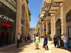 The new Mamilla open-air mall is an upscale shopping street in Jerusalem. Shopping Street, Civil Society, Fashion Photography Inspiration, Rural Area, Sustainable Development, Healthy People 2020, Shopping Center, Plaza, Social Work