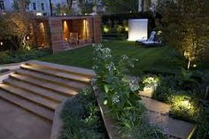 Create a magical space at night by lighting your garden. For garden lighting design and products, visit our projects or product section. Lighting Your Garden, Backyard Lighting, Outdoor Lighting, Lighting Ideas, Pathway Lighting, Small Backyard Gardens, Backyard Garden Design, Small Backyard Landscaping, Modern Backyard