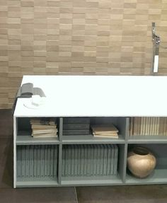 #bookshelf embedded in a modern #bathtub