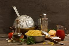 Macaroni and old metal tableware on the old table Stock Photo