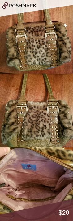 Kathy Van Zeeland Leopard and Gator Handbag Leppard and Gator Handbag by Kathy Van Zeeland  EUC no stains, no tears, no marks Front and back pocket on exterior.Two pouches and one zippered pocket on inside.  11in L 8in H 10in double strap drop Asking  $20 obo Kathy Van Zeeland Bags Shoulder Bags