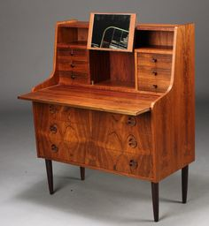 Danish bureau. Brazilian rosewood. 60's. neat flip out mirror!