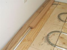 ThermoFin U and PEX tubing with hardwood flooring over an in-floor radiant heating installation. Patented by Radiant Engineering Inc, free small samples are available from www.radiantengineering.com. #thermofin #radiant #floor #heating