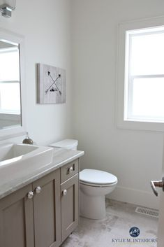 Benjamin Moore White Dove is a great off-white for home staging and selling. Shown in small bathroom with Kingsport Gray vanity