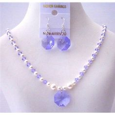 Price  :$27.99 Swarovski Lavender Crystals White Pearls Octagon Pendant Earrings Sets Material Used : Swarovski White Pearls 4mm & Swarovski Lavender Crystals 4mm with 15mm Swarovski Crystals Octagon Pendant & Earrings Necklace Length : 16 inches with 2 inches extenion & have lobster clasp
