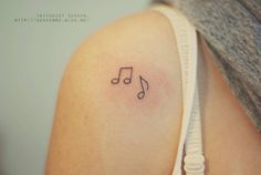 Minimalistic music note tattoos on the right shoulder. Tattoo artist: Seoeon