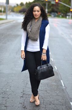 No boring white here, just a beautiful background for a full scarf, jewel-toned blue vest and a black bag.