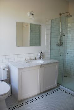 Master bathroom - Hexagonal tile floor, glass shower