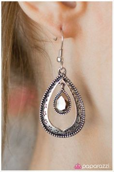Red Carpet Ready: An eye-catching rhinestone hangs from the center of an antique silver silhouette with a textured border. Buy now at www.paparazziaccessories.com!