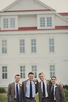Grey and Navy Groomsmen Suits. Groomsman shirts in light blue, groom in white