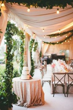 Tented but also this inspiration of softening an outdoor patio with draping and a mix of greenery garlands and festoon lighting. Other tented wedding reception ideas