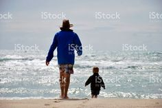 Father with Child at the Beach royalty-free stock photo The World Race, Interracial Marriage, Kiwiana, Beach Photos, Image Now, New Zealand, Royalty Free Stock Photos, Childhood, Father