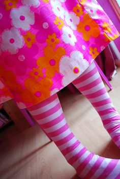 orange and pink - striped tights, retro flower skirt.